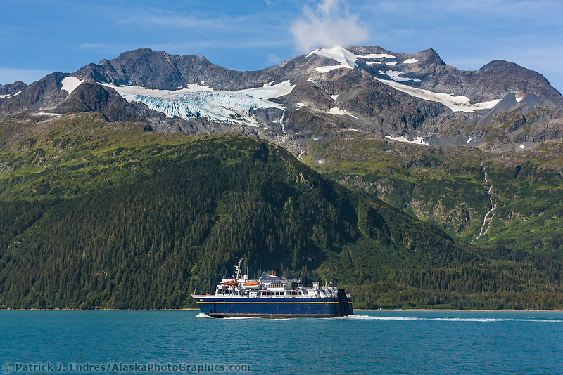 Alaska marine ferry vessel Aurora travels passage canal en route to Whittier. Chugach Mountains, Chugach National Forest, Prince William Sound, Alaska.