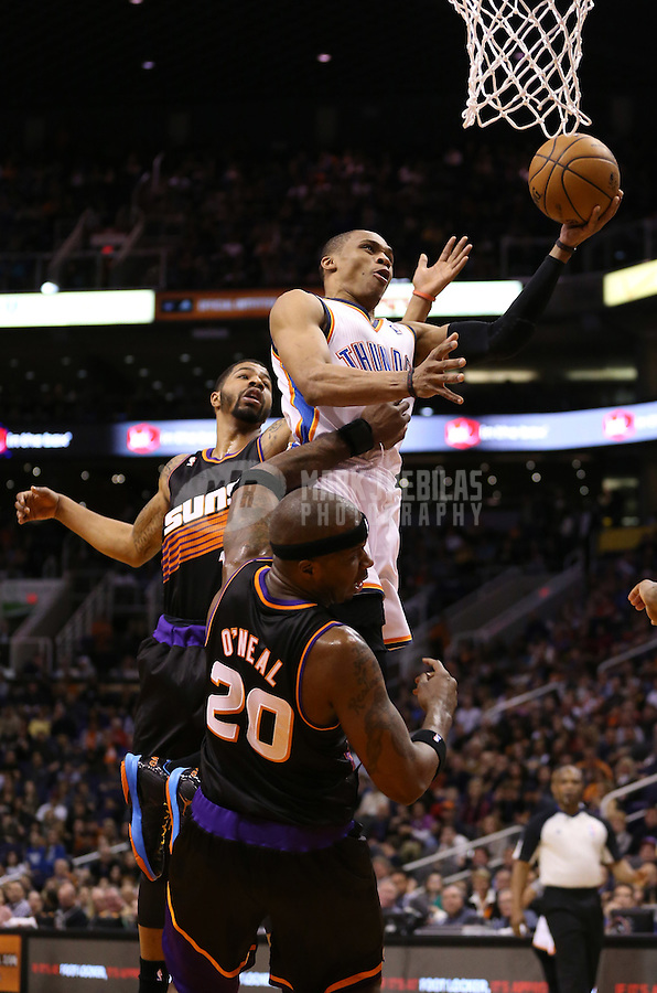 Feb. 10, 2013; Phoenix, AZ, USA: Oklahoma City Thunder guard Russell Westbrook (0) drives to the basket in the second quarter against the Phoenix Suns at the US Airways Center. Mandatory Credit: Mark J. Rebilas-