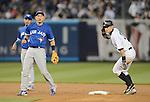 (R-L) Ichiro Suzuki (Yankees), Munenori Kawasaki (Blue Jays),.APRIL 26, 2013 - MLB :.Munenori Kawasaki of the Toronto Blue Jays and Ichiro Suzuki of the New York Yankees during the baseball game against the Toronto Blue Jays at Yankee Stadium in The Bronx, New York, United States. (Photo by AFLO)