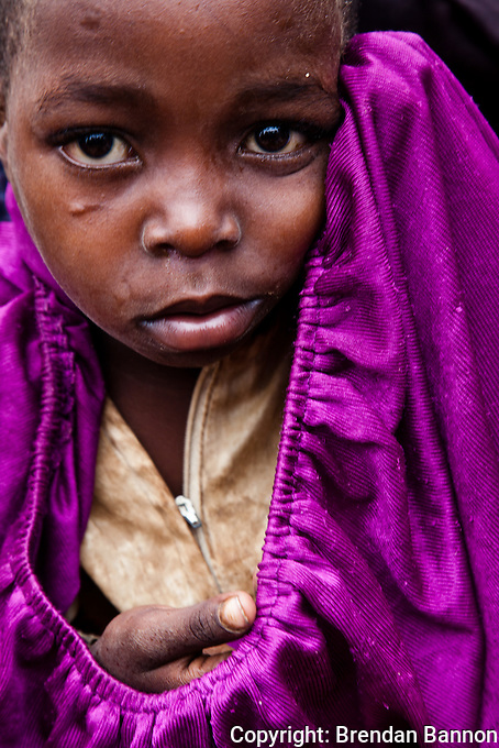 Portrait of a Somali refugee girl waiting to be settled in Ifo camp in Kenya. There are 390,000  acutely malnourished children in southern Somalia according to the United Nations.