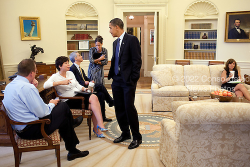 Washington, DC - August 13, 2009 -- United States President Barack Obama Oval Office listens to Valerie Jarrett during a meeting with senior staff in the Oval Office August 13, 2009. From left; White House Press Secretary Robert Gibbs,  Jarrett, White House Chief of Staff Rahm Emanuel, and Assistant to the President Mona Sutphen.  Seated at far right is Alyssa Mastromonaco, Director of Scheduling. .Mandatory Credit: Pete Souza - White House via CNP