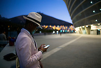 CAPE TOWN, SOUTH AFRICA JULY 2: A fashionable man chats on his phone while waiting for a show at South Africa Menswear week 2015 on July 2, 2015 in Cape Town, South Africa. The second edition of SAMW featured designers from South Africa and around Africa showing spring and summer collections during the 3-day event. (Photo by Per-Anders Pettersson)