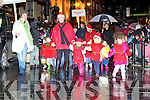 Kids from Muckross brave the weather to march at the Christmas in Killarney parade on Friday night..