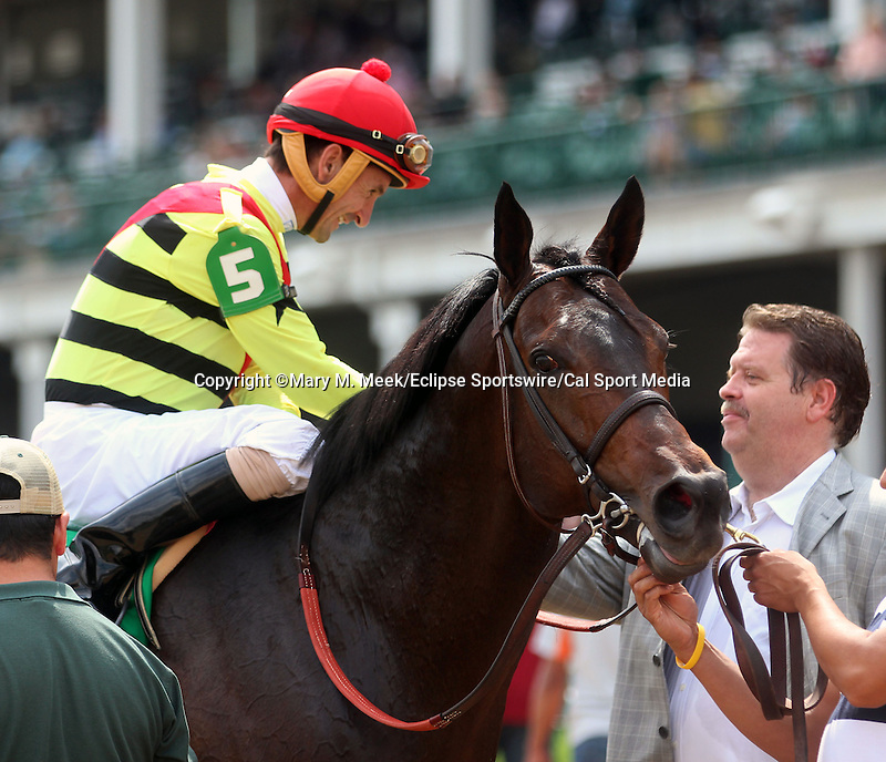 June 28, 2014:  Five year old horse Silver Max (Badge of Silver x Kissin Rene, by Kissin Kris) win the G2 Firecracker Stakes with jockey Robby Albarado. They are greeted by trainer Dale Romans after the race. Owners Mark Bacon and Dana Wells.  ©Mary M. Meek/ESW/CSM