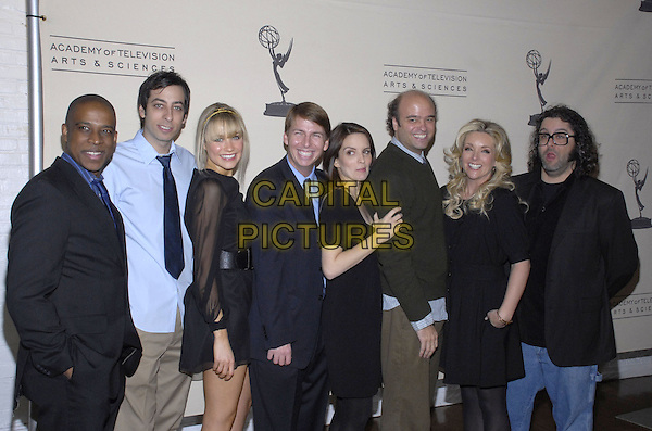 "KEITH POWELL, LONNY ROSS, KATRINA BOWDEN, JACK McBRAYER,  TINA FEY, SCOTT ADSIT, JANE KRAKOWSKI & JUDAH FRIEDLANDER.The Academy of Television Arts & Sciences shows how ""work can be such a production"" as the organization presents An Evening with ""30 Rock"" at the Puck Building, New York, New York, USA..December 6th, 2007.half length black dress sheer sleeves belt 3/4 jacket glasses .CAP/ADM/BL.©Bill Lyons/AdMedia/Capital Pictures. *** Local Caption ***"