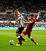 1st October 2017, St James Park, Newcastle upon Tyne, England; EPL Premier League football, Newcastle United versus Liverpool; Matt Ritchie of Newcastle United holds off a challenge from Alberto Moreno of Liverpool in the 1-1 draw