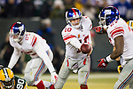 New York Giants quarterback Eli Manning (10) hands the ball off to running back Brandon Jacobs (27)/ during an NFL divisional playoff football game against the Green Bay Packers on January 15, 2012 in Green Bay, Wisconsin. The Giants won 37-20. (AP Photo/David Stluka)