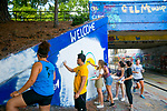 Duke students from Mi Gente and Desarrolla paint a logo for Hispanic Heritage Month on the East Campus bridge.
