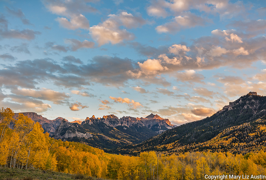 Uncompahgre National Forest, Colorado: Cliffs of the Cimarron stand above fall colored hillsides, San Juan Mountains