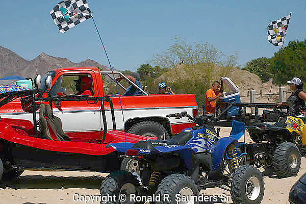 VEHICLES AND PEOPLE AT BAJA RACE