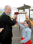 Chairperson of Louth County Council Cllr Oliver Tully and Aaliyah Flood unveil a plaque to officially open the new playground in Dunleer. Photo: Colin Bell/pressphotos.ie