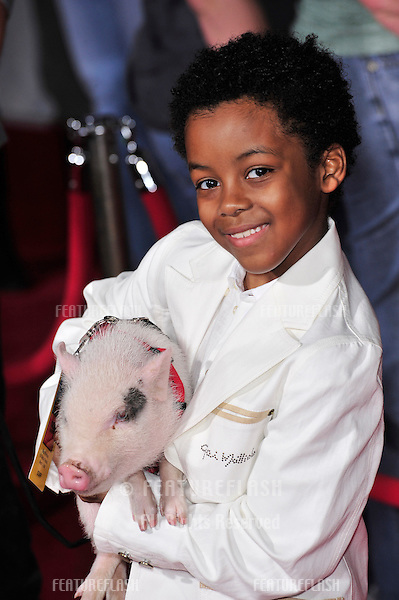 "Eshaya Draper with the pig from the movie at the world premiere of his new movie ""College Road Trip"" at the El Capitan Theatre, Hollywood..March 3, 2008  Los Angeles, CA.Picture: Paul Smith / Featureflash"