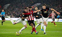 Sheffield United's Lys Mousset battles with Manchester United's Phil Jones and Harry Maguire <br /> <br /> Photographer Alex Dodd/CameraSport<br /> <br /> The Premier League - Sheffield United v Manchester United - Sunday 24th November 2019 - Bramall Lane - Sheffield<br /> <br /> World Copyright © 2019 CameraSport. All rights reserved. 43 Linden Ave. Countesthorpe. Leicester. England. LE8 5PG - Tel: +44 (0) 116 277 4147 - admin@camerasport.com - www.camerasport.com