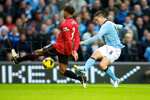 09.12.2012 Manchester, England. Manchester United's French defender Patrice Evra and Manchester City's French midfielder Samir Nasri in action during the Premier League game between Manchester City and Manchester United from the Etihad Stadium. Manchester United scored a late winner to take the game 2-3.