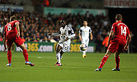 Pictured: Nathan Dyer of Swansea (C) against Steven Gerrard (L) and Jordan Henderson (R) both of Liverpool.<br /> Monday 16 September 2013<br /> Re: Barclay's Premier League, Swansea City FC v Liverpool at the Liberty Stadium, south Wales.