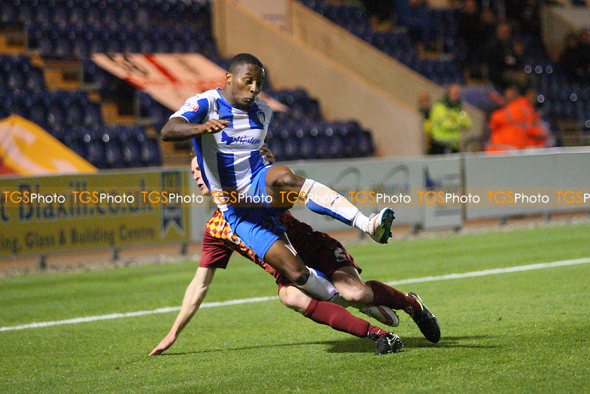 Stephen Darby of Bradford City challenges Callum Harriott of Colchester United during Colchester United vs Bradford City, Sky Bet League 1 Football at the Weston Homes Community Stadium, Colchester, England on 29/09/2015
