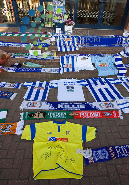 Tributes were today paid to Celtic and Kilmarnock  legend Tommy Burns, who died after losing his long-running battle with cancer as tributes are placed at Kilmarnock FC at Rugby Park in Kilmarnock..It was announced last month that Burns, 51, who was first diagnosed with skin cancer in 2006, was facing a new fight against the disease..He had been undergoing treatment in Glasgow and France in recent weeks..Celtic Football club said Burns died at home..Former Scotland international Burns was an ex-manager of Celtic and had been a long-serving player with the Glasgow club.Universal News And Sport (Scotland) 15 May 2008..................... ......... .