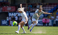 Chloe Page (X-Factor 2015) (left) steals the ball during the 'Greatest Show on Turf' Celebrity Event - Once in a Blue Moon Events at the London Borough of Barking and Dagenham Stadium, London, England on 8 May 2016. Photo by Andy Rowland.