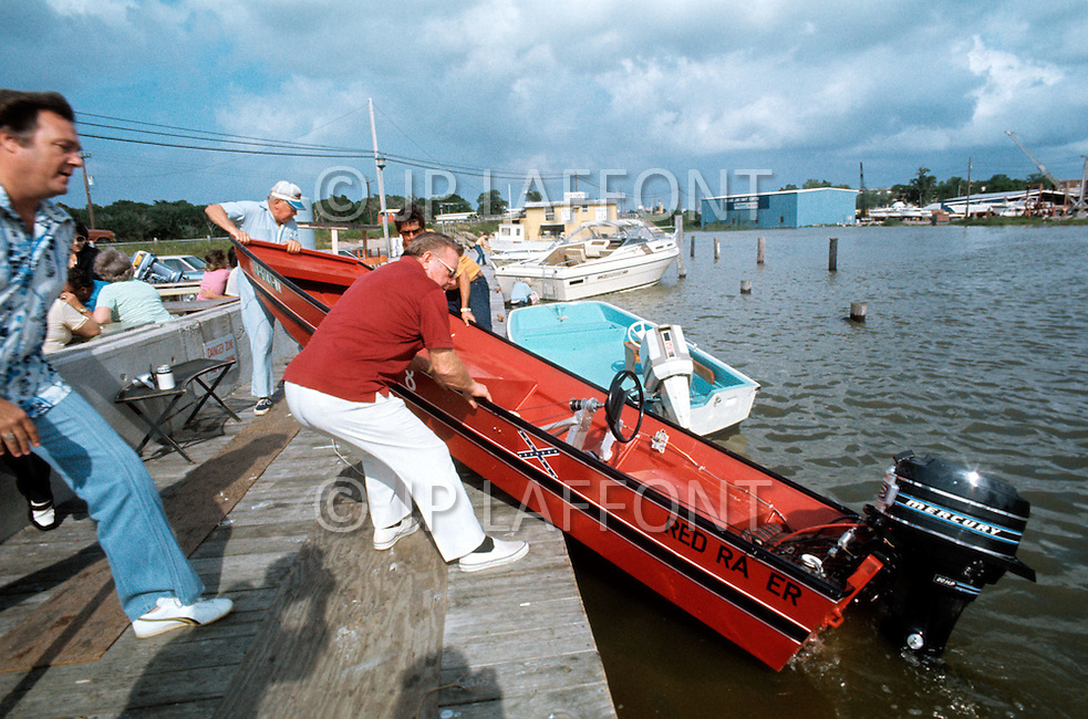 Houston, Texas - May 6, 1977. Red Adair comes back from a boat ride. Red Adair (June 18, 1915 - August 7, 2004) was an American oil well firefighter, who later became an innovator in the highly specialized profession of extinguishing and capping blazing or erupting oil well blowouts, both on land and offshore.