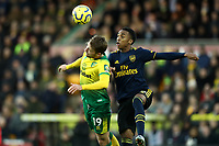 1st December 2019; Carrow Road, Norwich, Norfolk, England, English Premier League Football, Norwich versus Arsenal; Joe Willock of Arsenal competes for the ball with Tom Trybull of Norwich City - Strictly Editorial Use Only. No use with unauthorized audio, video, data, fixture lists, club/league logos or 'live' services. Online in-match use limited to 120 images, no video emulation. No use in betting, games or single club/league/player publications