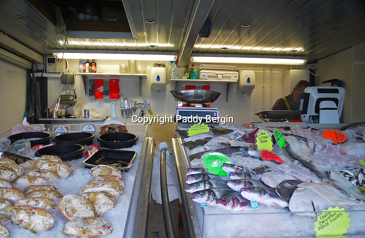 A fresh fish stall situated on the side of the River Arun and near the harbour and beach.<br />