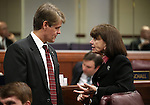 Nevada Assembly Republicans Chris Edwards and Robin Titus work on the Assembly floor at the Legislative Building in Carson City, Nev., on Monday, March 30, 2015. <br /> Photo by Cathleen Allison