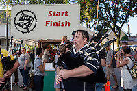 bagpipers playing during the start of the race at the start/finish line