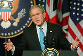 Washington, D.C. - December , 2006 -- United States President George W. Bush responds to a reporter's question during a joint press conference with Prime Minister Tony Blair of Great Britain at the White House in Washington, D.C. on Thursday, December 7, 2006..Credit: Ron Sachs / CNP