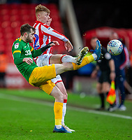 12th February 2020; Bet365 Stadium, Stoke, Staffordshire, England; English Championship Football, Stoke City versus Preston North End; Sam Clucas of Stoke City raises his boot against Tom Barkhuizen of Preston North End