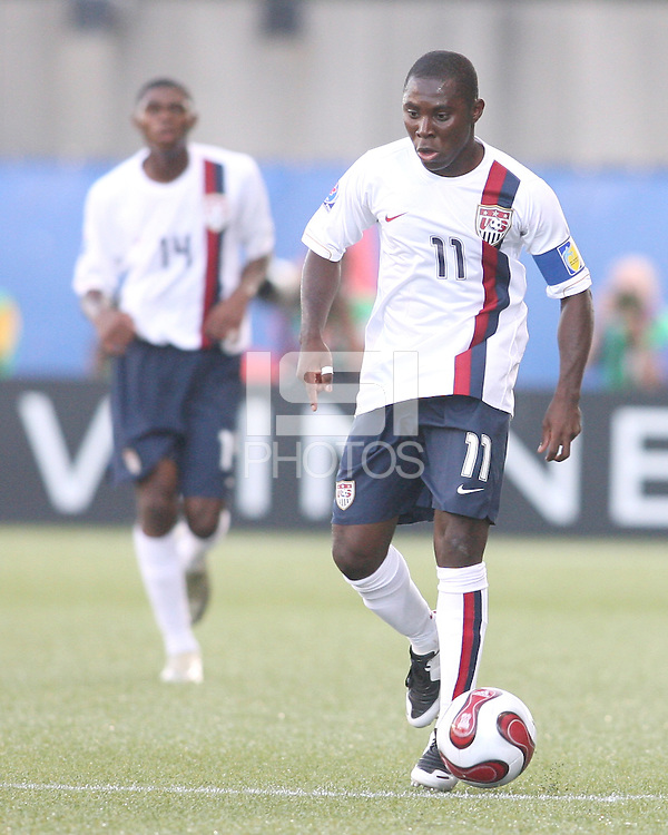 Freddy Adu pushes up field in front of Anthony Wallace. USA stunned Brazil, winning 2-1 to finish first in their group. Final game in group D in Ottawa, Ontario, on JULY 6 2007.