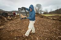 NWA Democrat-Gazette/BEN GOFF @NWABENGOFF<br /> Davanice Tasco with Fresh-N-Green Landscape Company based in Springdale plants daffodil bulbs Tuesday, Dec. 4, 2018, at Lake Bella Vista Park in Bentonville. A Walton Family Foundation grant at the recommendation of Steuart Walton is supporting a beautification project to plant 300,000 daffodil bulbs at sites in Bentonville this week. The 300,000 bulbs include 20 varieties of daffodils. Sites to be planted include the North Bentonville trail, sites on the Razorback Regional Greenway, the Seed Tick Shuffle trail at Slaughter Pen, the traffic circle on John DeShields Boulevard and Orchards Park.