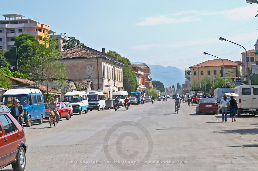 Street scene with cars bicycles, mopeds, pedestrians Shkodra. Albania, Balkan, Europe.