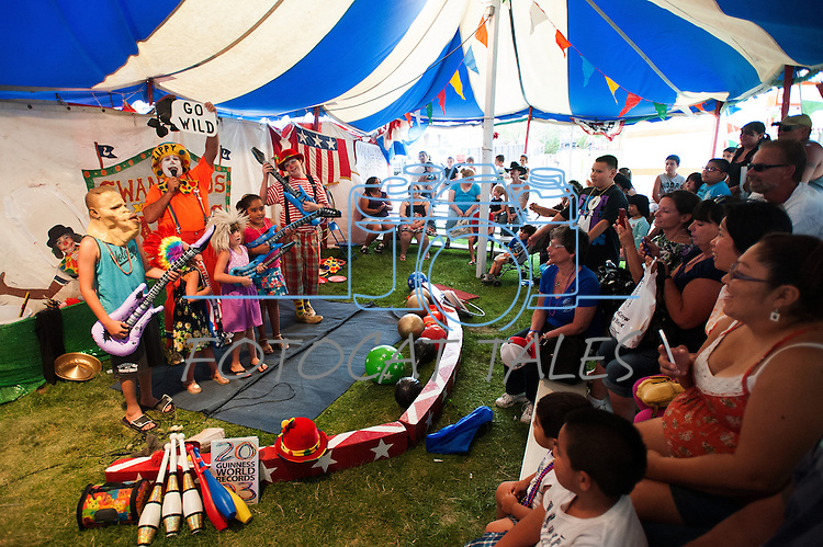 Kids and parent rock out in the Swan Brothers Circus tent during the NV150 Fair at Fuji Park in Carson City, Nev., on Saturday, August 2, 2014.<br /> (Photo By Kevin Clifford)
