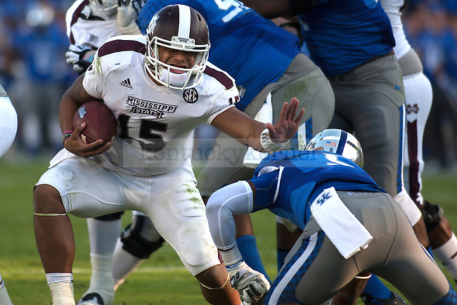Quarterback Dak Prescott of the Mississippi State Bulldogs stiff arms a defender on the way to a touchdown during the second half of the game against the Kentucky Wildcats at Commonwealth Stadium on Saturday, October 25, 2014 in Lexington, Ky. Mississippi State defeated Kentucky 45-31. Photo by Michael Reaves | Staff