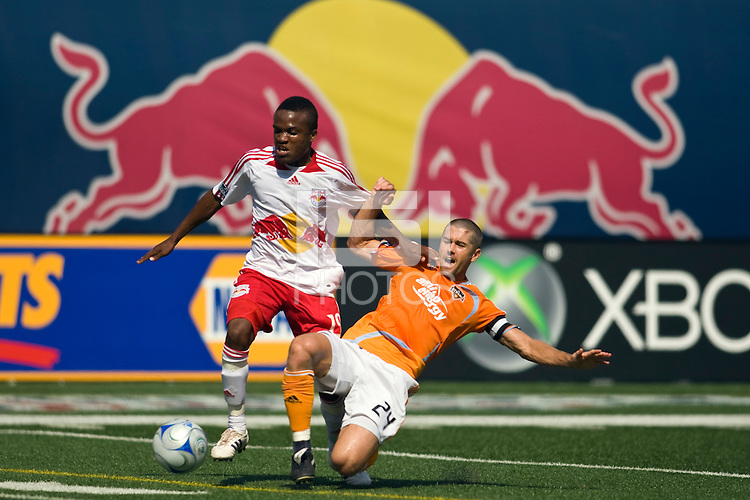 Houston Dynamo defender Wade Barrett (24) attempts a tackle on New York Red Bulls midfielder Dane Richards (19). The New York Red Bulls defeated the Houston Dynamo 3-0 during a Major League Soccer match at Giants Stadium in East Rutherford, NJ, on August 24, 2008.