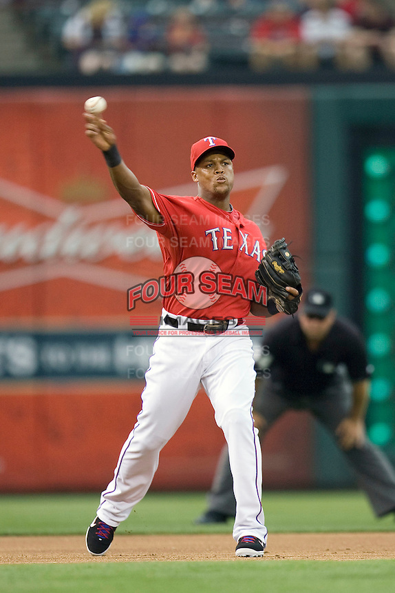 Texas Rangers third baseman Adrian Beltre (29) makes a throw against the Oakland Athetics in American League baseball on May 11, 2011 at the Rangers Ballpark in  Arlington, Texas. (Photo by Andrew Woolley / Four Seam Images)