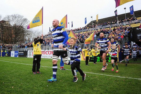 Matt Garvey of Bath Rugby, mascot in hand, runs out onto the field. Aviva Premiership match, between Bath Rugby and Saracens on December 3, 2016 at the Recreation Ground in Bath, England. Photo by: Patrick Khachfe / Onside Images