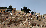 Palestinians walk on a land ready to be confiscated by israel authority as a cemetery for jewish in silwan  Jerusalem's old city on May 23, 2012. Photo by Mahfouz Abu Turk