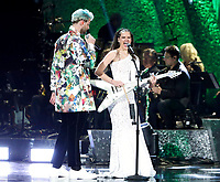 "Tucker Halpern, left, and Sophie Hawley-Weld of ""Sofi Tukker"" perform at the 61st annual Grammy Awards on Sunday, Feb. 10, 2019, in Los Angeles. (Photo by Matt Sayles/Invision/AP)"
