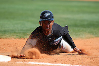 Toronto Blue Jays Anthony Gose #43 dives back to first during an exhibition game vs. Team Canada at Al Lang Field in St. Petersburg, Florida;  March 4, 2011.  Toronto defeated Team Canada 9-0.  Photo By Mike Janes/Four Seam Images