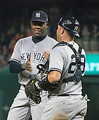 New York Yankees relief pitcher Aroldis Chapman (54) and catcher Austin Romine (28) celebrate their team's victory over the Washington Nationals at Nationals Park in Washington, D.C. on Monday, June 18, 2018.  This is the make-up game that was scheduled to be played on May 16, 2018 that was postponed due to rain.  The Yankees won the game 4 - 2.<br /> Credit: Ron Sachs / CNP<br /> (RESTRICTION: NO New York or New Jersey Newspapers or newspapers within a 75 mile radius of New York City)
