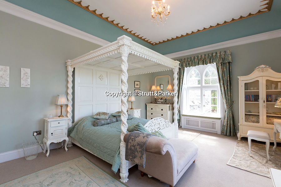 BNPS.co.uk (01202 558833)<br /> Pic:  Strutt&Parker/BNPS<br /> <br /> A magnificent 19th century Welsh castle has emerged on the market for £2.85million.<br /> <br /> Glandyfi Castle looks out across the picturesque Dovey Estuary to the mountains of Snowdonia national park in north west Wales.<br /> <br /> The 10 bedroom Gothic style property with octagonal towers and imposing chimneys stands high on wooded hillside.<br /> <br /> The castle, which was built out of local stone, has recently undergone a major renovation, with a new glass roof for the courtyard.