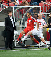 16 May 09: Chicago Fire defender Tim Ward #5 and Toronto FC midfielder Dewayne DeRosario #14 battle for a ball as Toronto FC head coach Chris Cummings looks on during action at BMO Field in a game between the Chicago Fire and Toronto FC..Chicago Fire won 2-0..