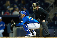 Durham Bulls catcher Mac James (28) sets a target a home plate umpire Richard Riley looks on during the game against the Gwinnett Braves at Durham Bulls Athletic Park on April 20, 2019 in Durham, North Carolina. The Bulls defeated the Braves 3-2 in game two of a double-header. (Brian Westerholt/Four Seam Images)