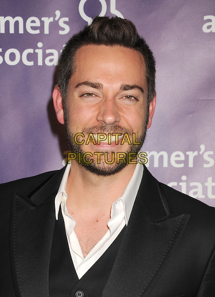"Zachary Levi.21st Annual ""A Night At Sardi's"" Gala Benefiting The Alzheimer's Association Held At Beverly Hilton Hotel, Beverly Hills, California, USA..20th March 2013..headshot portrait black white shirt beard facial hair smiling .CAP/ROT/TM.©Tony Michaels/Roth Stock/Capital Pictures"