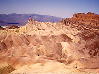 LAND SHAPING BY WIND AND WATER EROSION<br /> Zabriskie Point, Manley Beacon<br /> Death Valley National Monument, CA<br />  The fine grain mud & siltstone prevent absorption of much water. The large runoff causes deep furrowing creating badlands that support almost no vegetation.