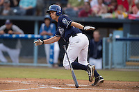 Asheville Tourists second baseman Michael Benjamin #18 swings at a pitch during a game against the Savannah Sand Gnats at McCormick Field July 17, 2014 in Asheville, North Carolina. The Tourists defeated the Sand Gnats 8-7. (Tony Farlow/Four Seam Images)