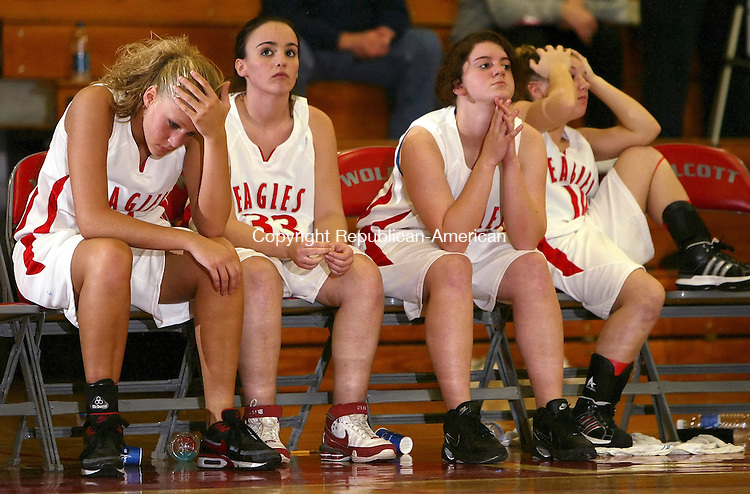 WOLCOTT, CT, 01/13/08- 011309BZ14-   Wolcott's Kiersten Kane (4) Coreene Charrette (33) Meghan Dunn (32) and Kayleigh Kirkendall (10) watch the final seconds tick away in their overtime loss to Watertown Tuesday night.<br />  Jamison C. Bazinet Republican-American