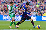 Lionel Andres Messi of FC Barcelona (R) competes for the ball with Jose Andres Guardado Hernandez of Real Betis (L) during the La Liga 2018-19 match between FC Barcelona and Real Betis at Camp Nou, on November 11 2018 in Barcelona, Spain. Photo by Vicens Gimenez / Power Sport Images