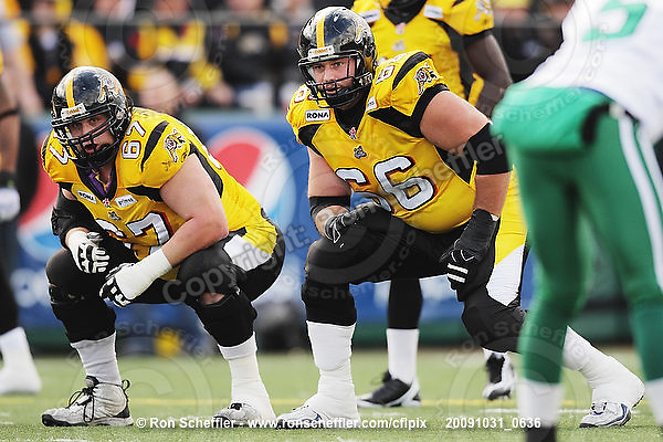 October 31, 2009; Hamilton, ON, CAN;  Hamilton Tiger-Cats offensive lineman Peter Dyakowski (67), offensive lineman Alexandre Gauthier (66). CFL football: Saskatchewan Roughriders vs. Hamilton Tiger-Cats at Ivor Wynne Stadium. The Tiger-Cats defeated the Roughriders 24-6. Mandatory Credit: Ron Scheffler. Copyright (c) 2009 Ron Scheffler.